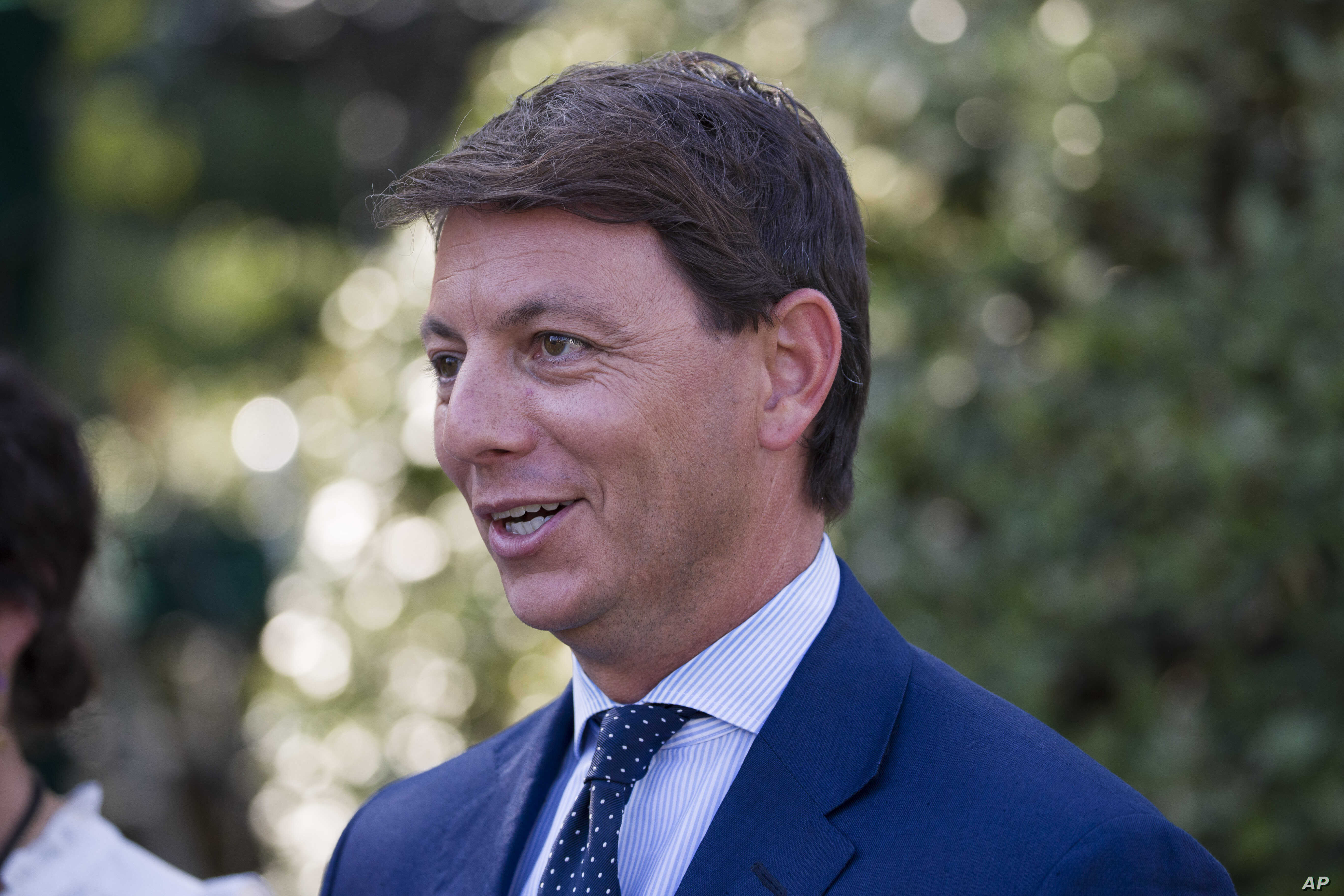 Deputy White House press secretary Hogan Gidley walks back to the West Wing after a television interview at the White House, Tuesday, Aug. 6, 2019, in Washington. (AP Photo/Alex Brandon)