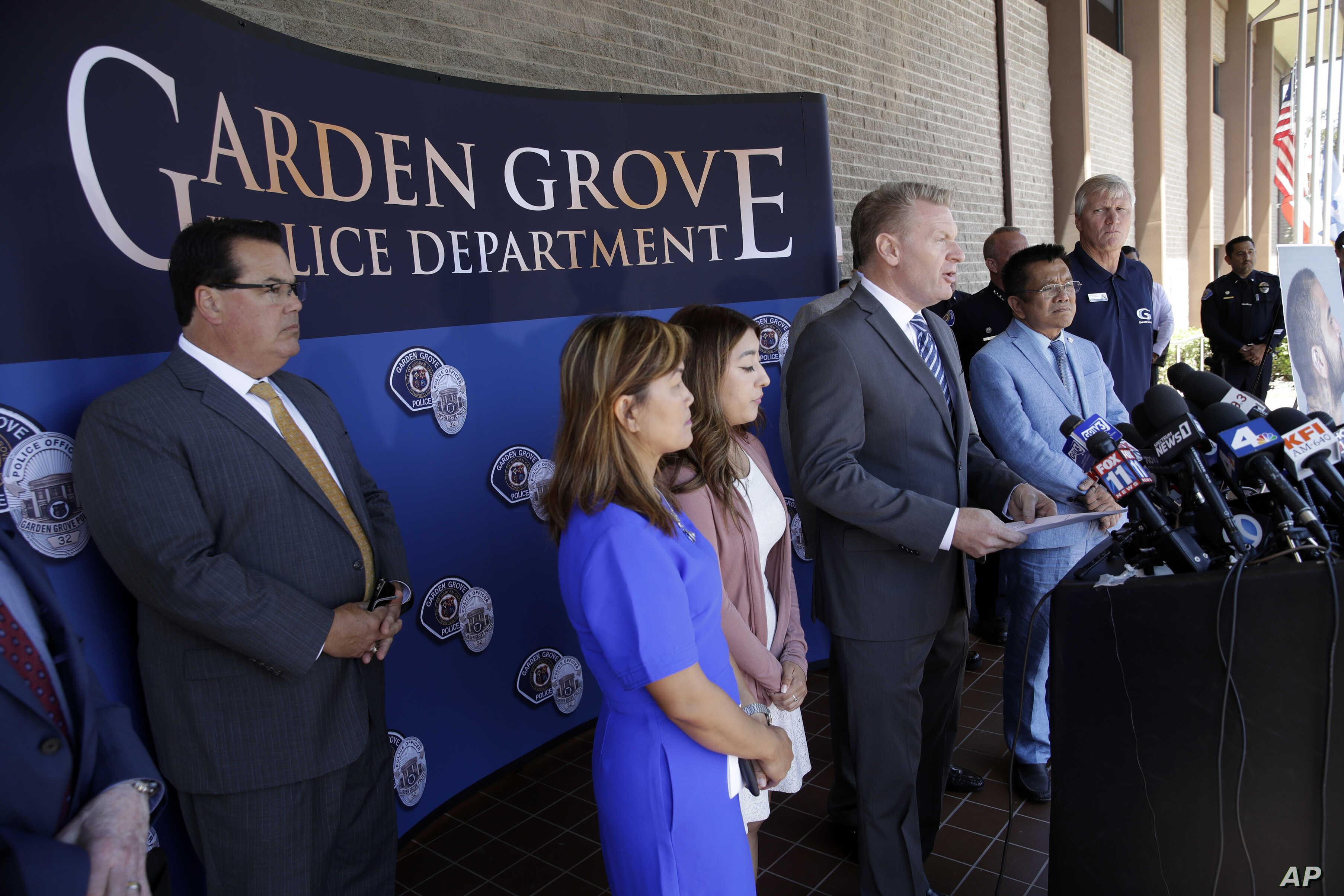 Garden Grove Mayor Steven R. Jones, fourth from left, speaks during a news conference following the arrest of Zachary Castaneda outside of the Garden Grove Police Department headquarters in Garden Grove, Calif., Thursday, Aug. 8, 2019. Investigators…