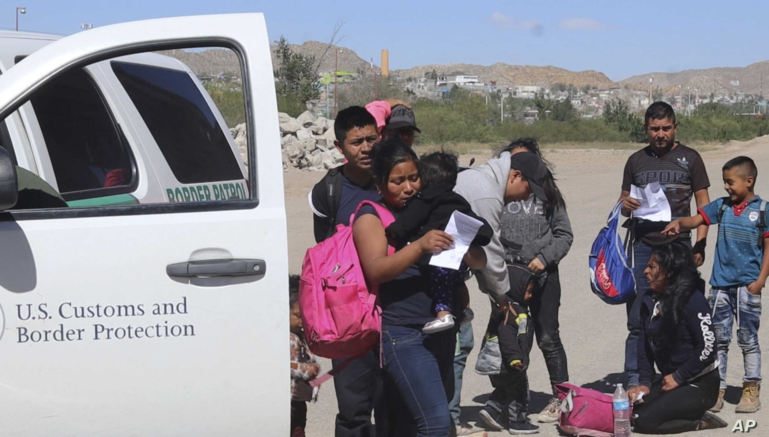 In this April 2019, frame from video, migrants turn themselves in to border agents in El Paso, Texas, after crossing the US - Mexico border. El Paso has swiftly become one of the busiest corridors for illegal border crossings in the U.S. after years…