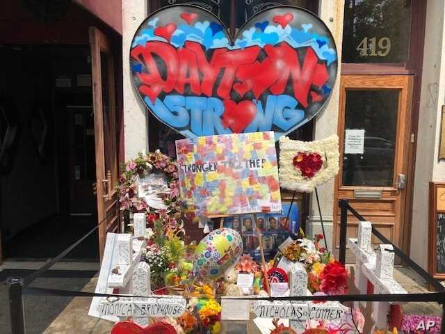 A makeshift memorial sits outside Ned Peppers nightclub in the Oregon District entertainment neighborhood where on Aug. 4 a gunman killed nine people, on Wednesday, Aug. 14, 2019, in Dayton Ohio(AP Photo/Dan Sewell)