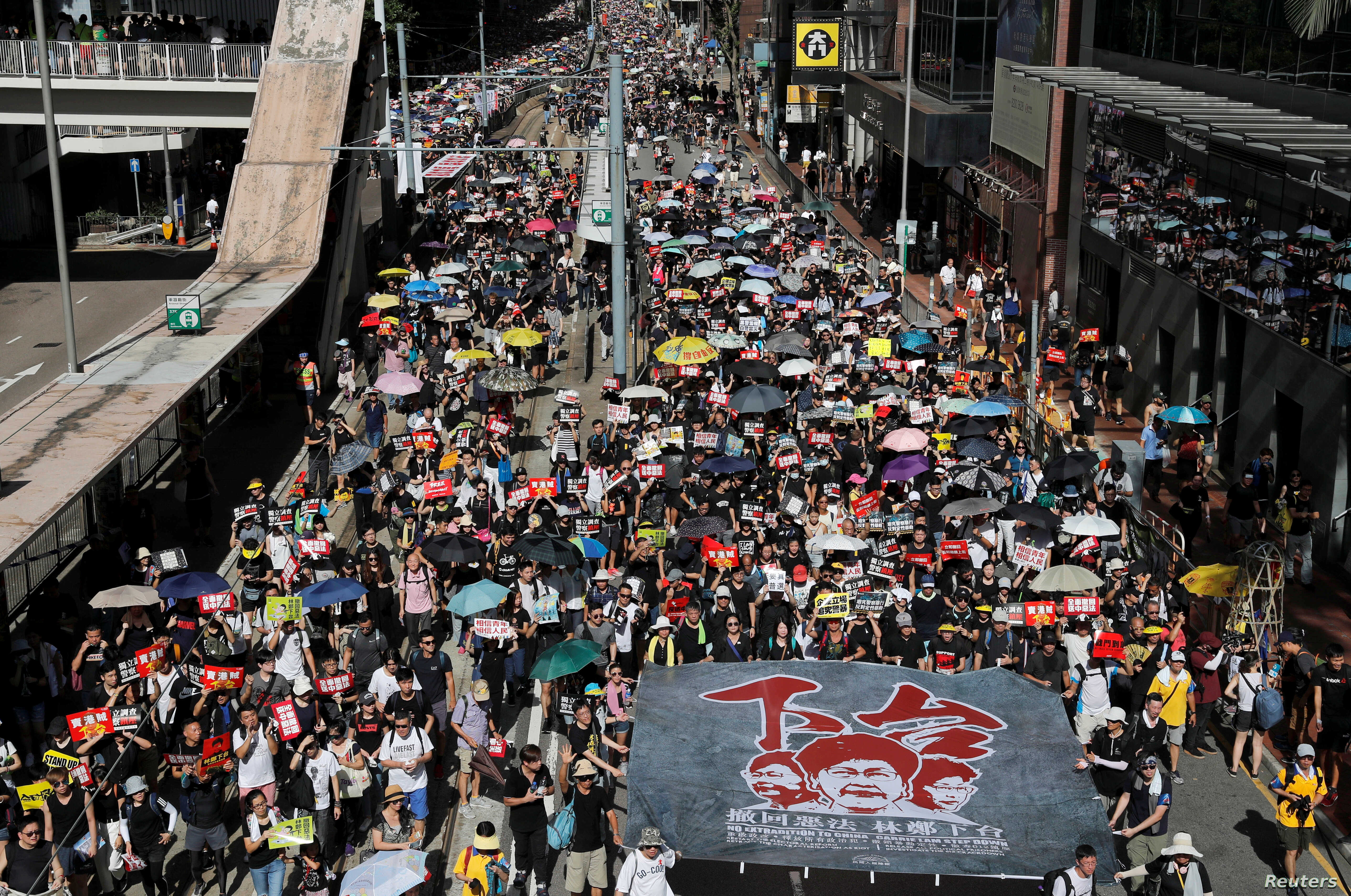 Anti-extradition bill protesters march during the anniversary of Hong Kong's handover to China in Hong Kong