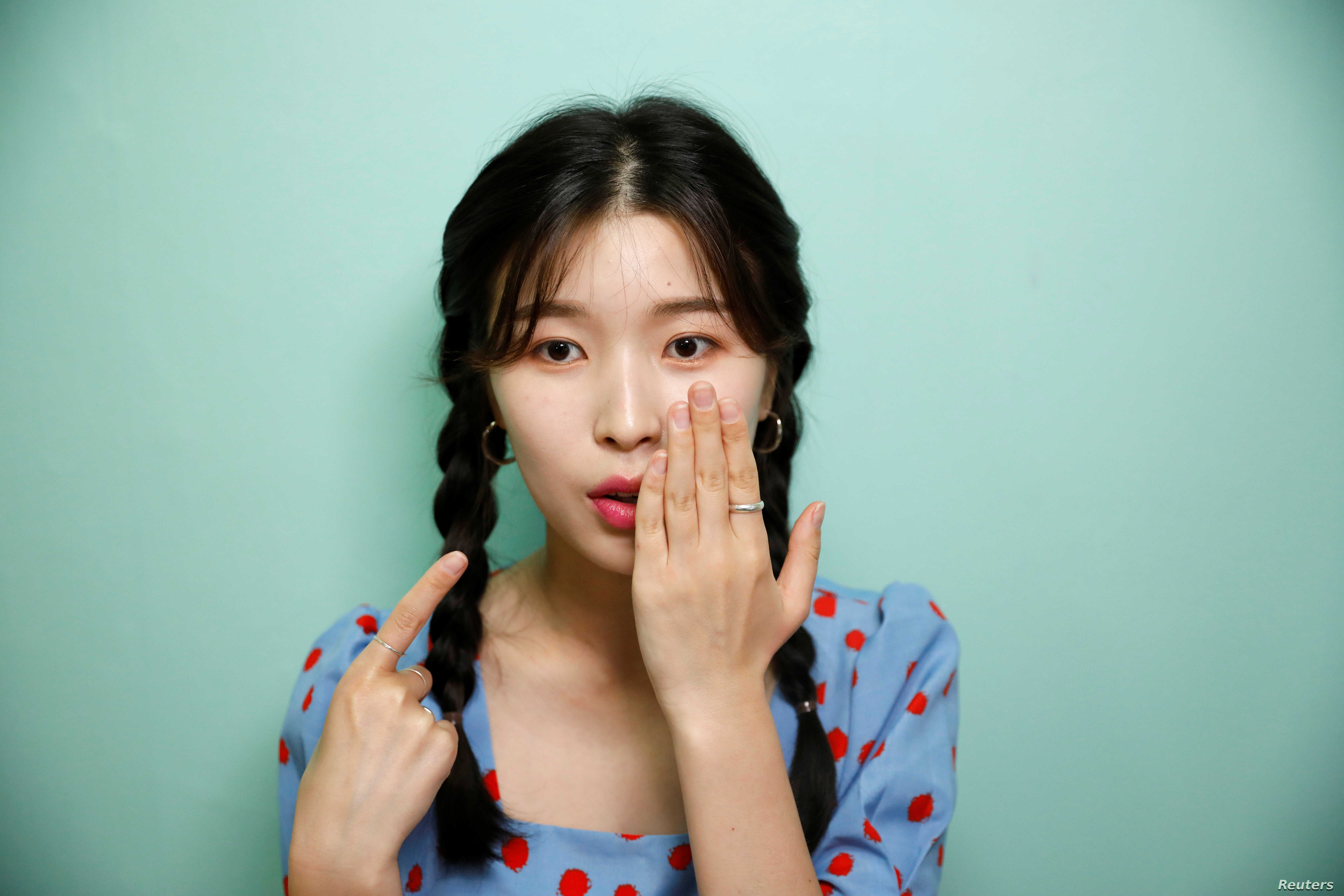 Kang Na-ra, a North Korean defector who is now a beauty YouTuber, points at her lips after putting on a lipstick made by North Korea, in Seoul, South Korea, June 11, 2019.