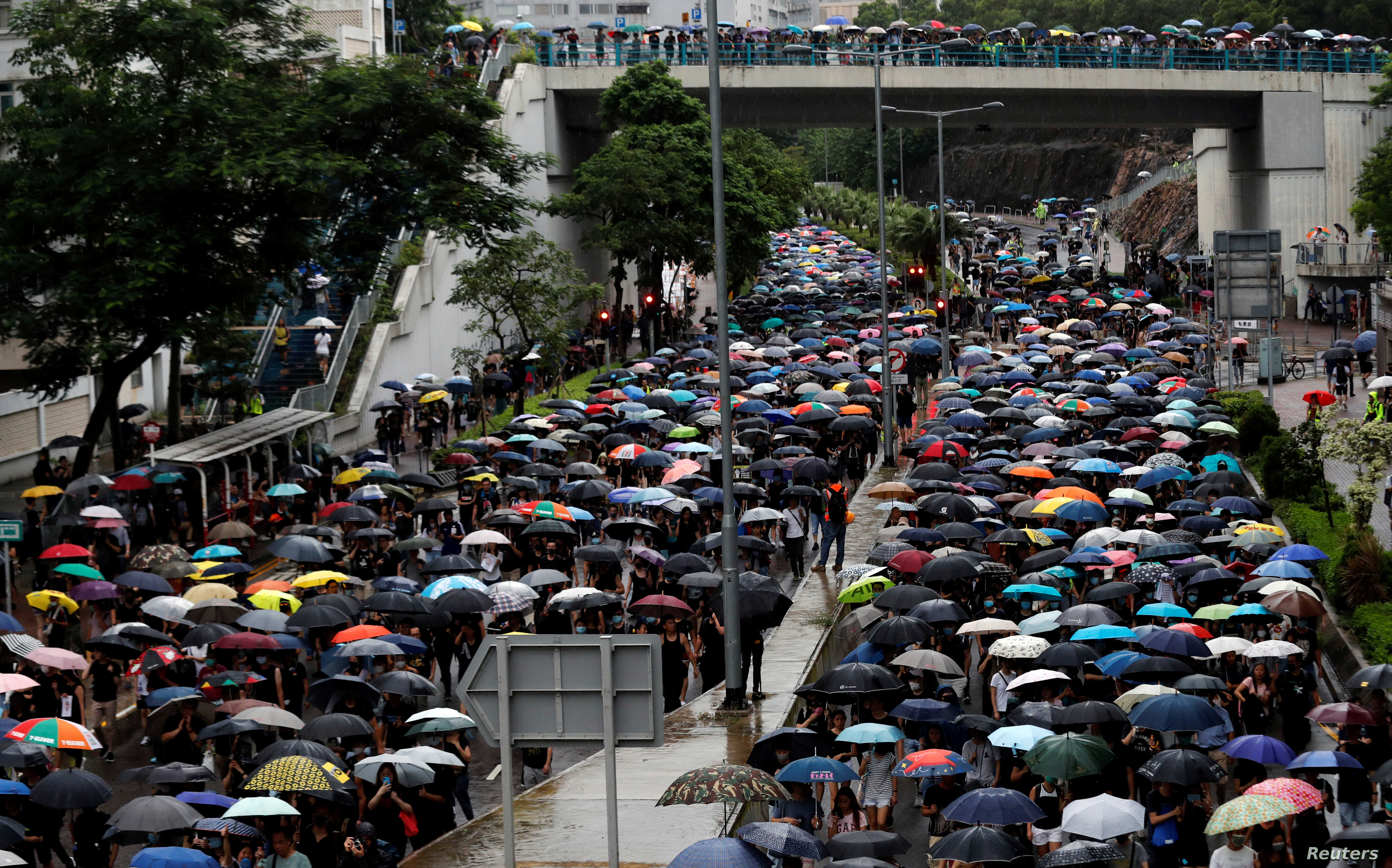 "People take part in the ""Reclaim Hung Hom and To Kwa Wan, Restore Tranquility to Our Homeland"" demonstration against the extradition bill in To Kwa Wan neighborhood, Hong Kong, Aug. 17, 2019."