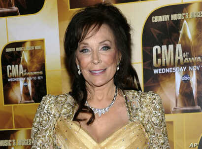 FILE - In this Nov. 10, 2010 file photo, singer Loretta Lynn poses in the press room during the 44th Annual Country Music Awards in Nashville, Tennessee.