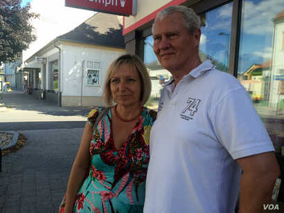 Thomas Braun, an off-duty police officer, and his wife, Brigitte, pictured in Gaserndorf, Austria, say they don't agree with everything the far right Freedom Party says, but they feel other parties have not laid out concrete plans to do anything, Jul...