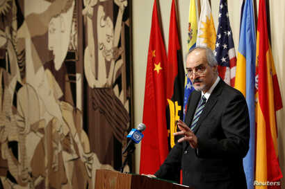 Syrian Ambassador to the United Nations Bashar al-Jaafari addresses the media following a United Nations Security Council vote aimed at ensuring that U.N. officials can monitor evacuations from besieged parts of the Syrian city of Aleppo, at the Uni...