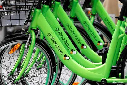 "Several ""Gobee.bike"" bicycles, a city bike-sharing service, by Hong Kong startup Gobee.bike, are seen on a sidewalk in Paris, France, Oct. 10, 2017."