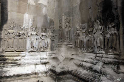 In this July 19, 2012 photo, Apsara sculptures are carved on a wall of the Angkor Wat temple complex in Siem Reap, northwest of Phnom Penh, Cambodia.