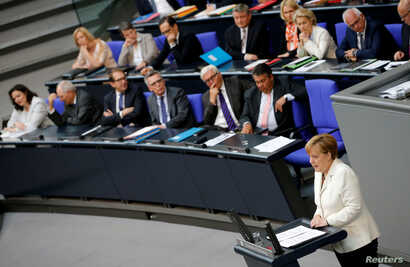 German Chancellor Angela Merkel (R) delivers a government declaration on the consequences of the Brexit vote at the lower house of parliament Bundestag in Berlin, Germany, June 28, 2016.