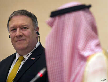 U.S. Secretary of State Mike Pompeo, left, listens to Saudi Arabia's Foreign Minister Adel al-Jubeir, during a joint press conference at the Royal Terminal of King Khaled airport, in Riyadh, Saudi Arabia, Sunday, April 29, 2018.