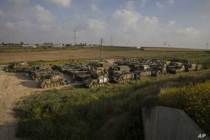 Israeli army artillery is seen deployed near the border with Gaza, in southern Israel, March 27, 2019.