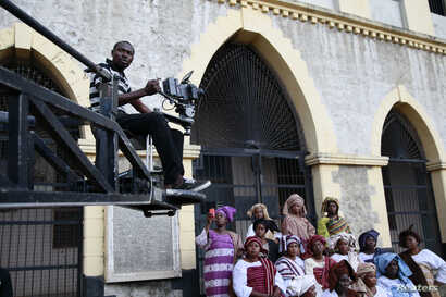 "FILE - A cameraman films a scene from a crane during the making of ""Ake,"" a film based on the childhood memoirs of Nigerian writer Wole Soyinka, in Abeokuta, southwest Nigeria, July 14, 2013. Nigeria's movie business, often known as Nollywood, is one..."