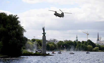 A helicopter from the US Army lands during a drill including the US Army and German federal police ahead of the upcoming G-20 Summit near the Alster river in Hamburg, Germany, July 4, 2017.