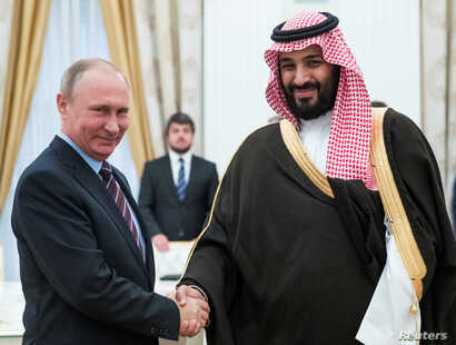 Russian President Vladimir Putin shakes hands with Saudi Deputy Crown Prince and Defence Minister Mohammed bin Salman during a meeting at the Kremlin in Moscow, Russia, May 30, 2017.
