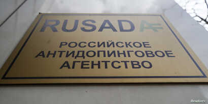 FILE - A sign is on display outside the office of Russian Anti-Doping Agency (RUSADA) in Moscow, March 28, 2018.