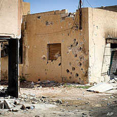 Heavy gunfire pockmarks houses in the Bira neighborhood in Misrata, a rebel bastion 120 kms (75 miles) east of Tripoli, on April 15, 2011
