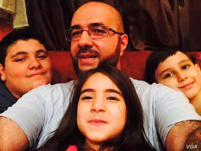 Khairullah with his three children, aged six, seven and thirteen. (Photo: Courtesy Mohamed Khairullah)