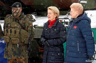 German Minister of Defense Ursula von der Leyen and Lithuanian President Dalia Grybauskaite visit German troops deployed as part of NATO enhanced Forward Presence battle group in Rukla military base, Lithuania, Feb. 4, 2019.