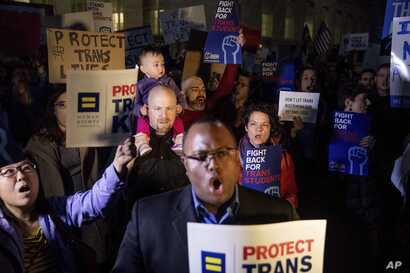 Activists and protesters with the National Center for Transgender Equality rally in front of the White House, Feb. 22, 2017 after President Trump announced he would revoke guidelines for protecting transgender students.