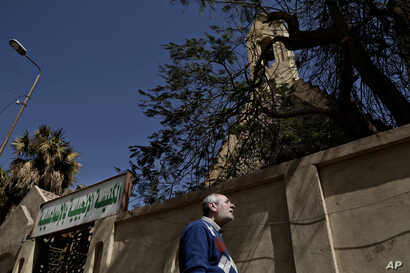 A Christian man who fled el-Arish stands outside the Evangelical Church in Ismailia, 120 kilometers (75 miles) east of Cairo, Egypt, Sunday, Feb. 26, 2017.