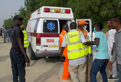 Rescue workers are seen at the site of an attack by Boko Haram militants in the northeast city of Maiduguri, Nigeria April 27, 2018.