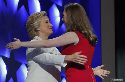 Democratic presidential nominee Hillary Clinton hugs her daughter Chelsea as she arrives to accept the nomination on the fourth and final night at the Democratic National Convention in Philadelphia, Pennsylvania, U.S. July 28, 2016.