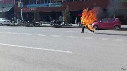This citizen journalist image shows a Tibetan man self-immolating in Labrang, China, October 23, 2012.