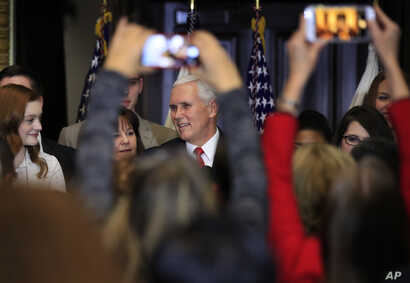 Vice President Mike Pence with his wife Karen Pence speaks to anti-abortion supporters and participants of the annual March for Life event, during a reception at the White House in Washington, Jan. 18, 2018.
