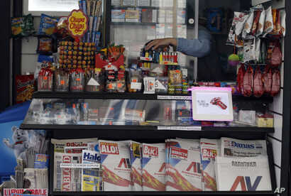 Seven major newspaper, featured at this vendor's kiosk in Belgrade, Serbia, hit the stands with the same front pages of the ruling candidate's campaign poster, March 30, 2017