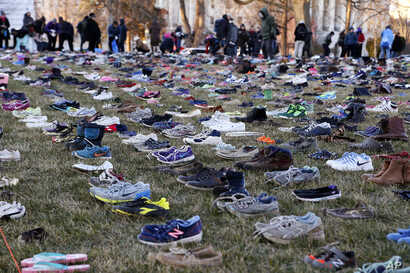 In this display in Washington, empty pairs of shoes — symbolizing the children killed by guns in the United States since the Sandy Hook shootings in 2012 — sit on the southeast lawn of the U.S. Capitol, March 13, 2018.