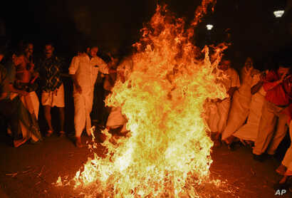 Opposition Congress party activists burn an effigy of Chief Minister Pinarayi Vijayan reacting to reports of two women of menstruating age entering the Sabarimala temple, one of the world's largest Hindu pilgrimage sites, in Thiruvananthapuram, Keral...