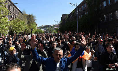 Demonstrators attend a protest against Armenia's ruling Republican party's nomination of former President Serzh Sarksyan as its candidate for prime minister, in Yerevan, Armenia, April 16, 2018.