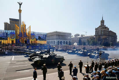 Tanks pass during a military parade marking Ukraine's Independence Day in Kyiv, Ukraine, Aug. 24, 2018.