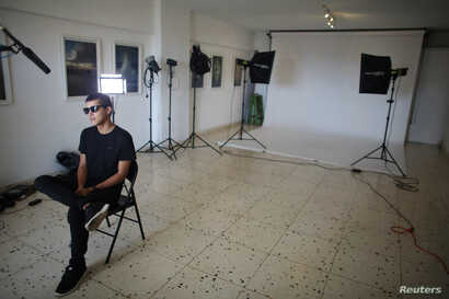 Robin Pedraja, 29, editor of the digital magazine Vistar, speaks during an interview at its studio in Havana, Cuba, Aug. 11, 2016.