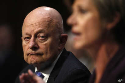 Former National Intelligence Director James Clapper listens as former acting Attorney General Sally Yates testifies on Capitol Hill in Washington, May 8, 2017