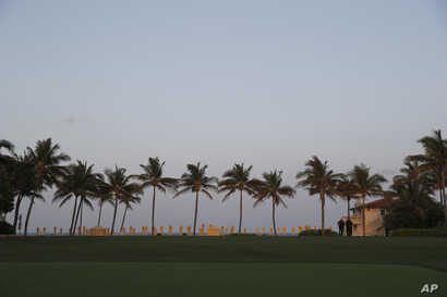 Palm trees line the lawn at Mar-a-Lago where President Donald Trump and Chinese President Xi Jinping are meeting in Palm Beach, Florida, April 6, 2017.