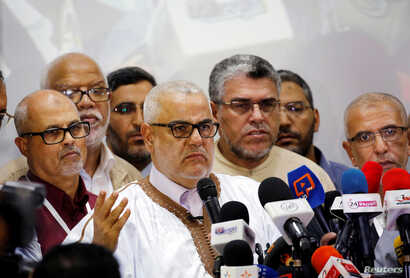 Abdelilah Benkirane, secretary-general of Morocco's Islamist Justice and Development Party, speaks during a new conference at the party's headquarters in Rabat, Morocco, early October 8, 2016.