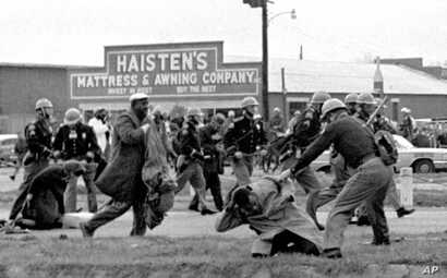 FILE - Alabama state troopers use clubs against voting rights marchers in Selma on March 7, 1965. At foreground right, John Lewis, chairman of the Student Nonviolent Coordinating Committee, is beaten. That 'Bloody Sunday' spurred passage of the Votin...