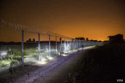 Night shots of the newly erected border fence in Asotthalom, Hungary. (Gabor Ancsin / VOA)