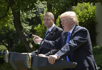 President Donald Trump, right, speaks during a news conference with Romania's President Klaus Werner Iohannis, left, in the Rose Garden of the White House, June 9, 2017.