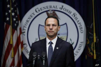 Pennsylvania Attorney General Josh Shapiro speaks about a grand jury's report on clergy abuse in the Roman Catholic Church during a news conference at the Capitol in Harrisburg, Aug. 14, 2018.