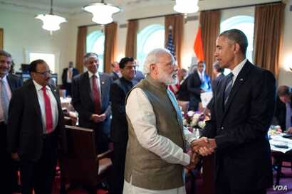 President Barack Obama and Prime Minister Narendra Modi of India talk after a working lunch in the Cabinet Room of the White House, June 7, 2016.