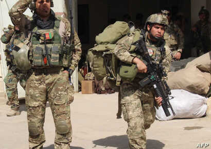 Afghan special forces arrive at the airport as they launch a counteroffensive to retake the city from Taliban insurgents, in Kunduz, Sept. 29, 2015.