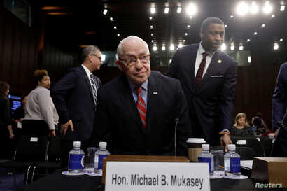 Former U.S. attorney general Michael Mukasey takes a seat before a Senate Judiciary Committee nomination hearing for William Barr to be attorney general of the U.S., on Capitol Hill in Washington, Jan. 16, 2019.