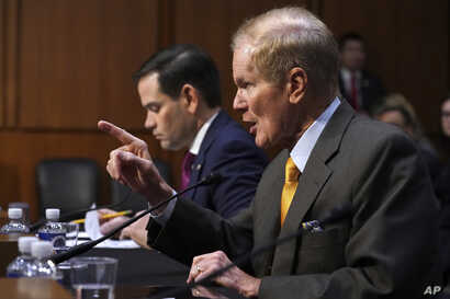 Sen. Marco Rubio, R-Florida, left, listens as Sen. Bill Nelson, D-Florida, speaks during a Senate Judiciary Committee hearing on the Parkland, Florida, school shootings and school safety, March 14, 2018, on Capitol Hill in Washington.