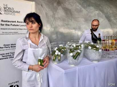 """Green moringa after-party booster juice,"" made from the drought-resistance moringa plant, is offered to diners at a ""Future 50 Foods"" tasting at the Pompidou Center in Paris."