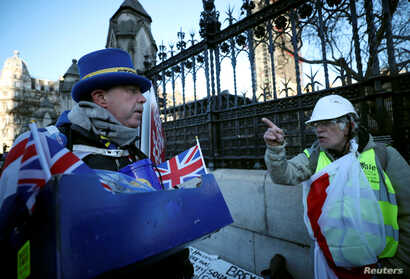 A pro-Brexit protester argues wth anti-Brexit campaigner Steve Bray outside the Houses of Parliament in London, Jan. 28, 2019.