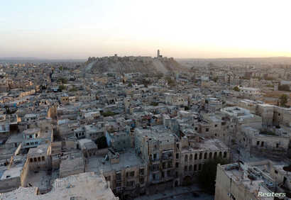 A general view taken with a drone shows the Old City of Aleppo and Aleppo's historic citadel, Syria, Oct. 12, 2016.