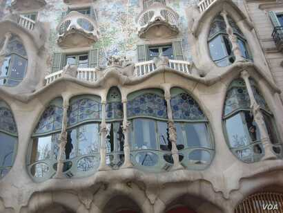 A close-up view of Casa Batllo's facade, which shows its skeletal quality, which has led locals to refer to the structure as House of Bones, in Barcelona.