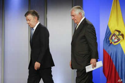 Colombia's President Juan Manuel Santos, left, and U.S. Secretary of State Rex Tillerson walk away after a press conference at the presidential palace in Bogota, Colombia, Tuesday, Feb. 6, 2018.